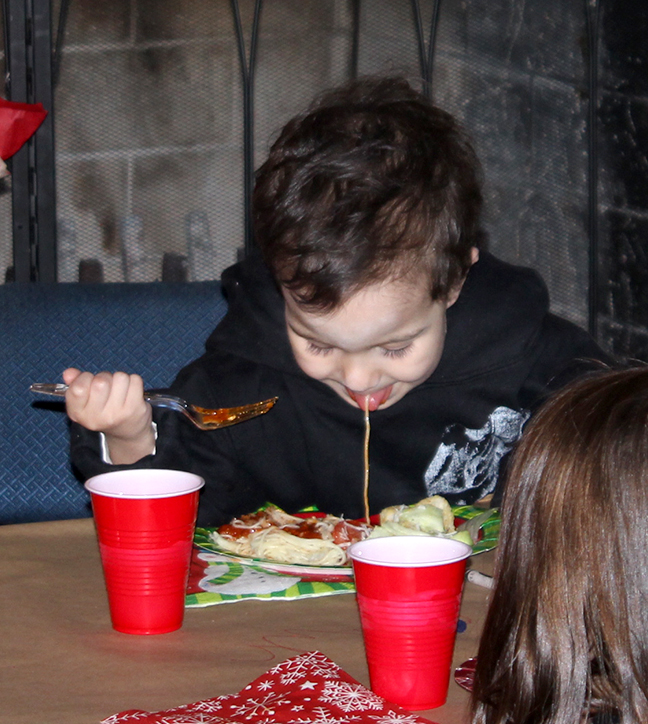 Dillinger eats spaghetti